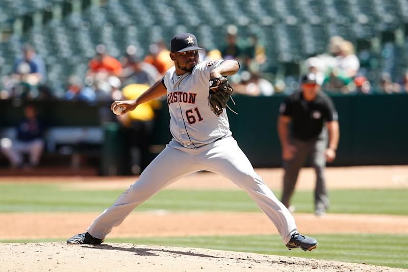 OAKLAND, CALIFORNIA - AUGUST 17: Rogelio Armenteros #61 of the Houston Astros pitches against the Oakland Athletics at Ring Central Coliseum on August 17, 2019 in Oakland, California. (Photo by Lachlan Cunningham/Getty Images)