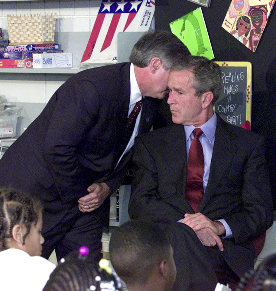 FILE - In this Sept. 11, 2001 file photo, President Bush's Chief of Staff Andy Card whispers into the ear of the President to give him word of the plane crashes into the World Trade Center, during a visit to the Emma E. Booker Elementary School in Sarasota, Fla. George W. Bush knows that history will shape his legacy more than anything he can say. But that's not gonna stop a guy from trying. After two years of near silence, Bush is back. With his new memoir and a promotion tour, the president who in cockier times could not think of a single mistake he had made, lists many.