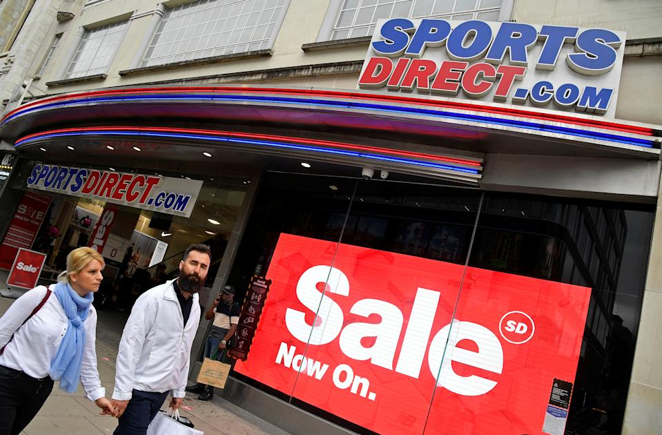 Shoppers walk past a branch of Sports Direct in Oxford Street, London, Britain, July 15, 2020. REUTERS/Toby Melville