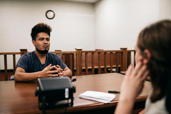 Caitlin Dickson of Yahoo News interviews Luis Bautista-Martinez in a courtroom at the LaSalle ICE detention center in Jena, La. (Photo: Bryan Tarnowski for Yahoo News)