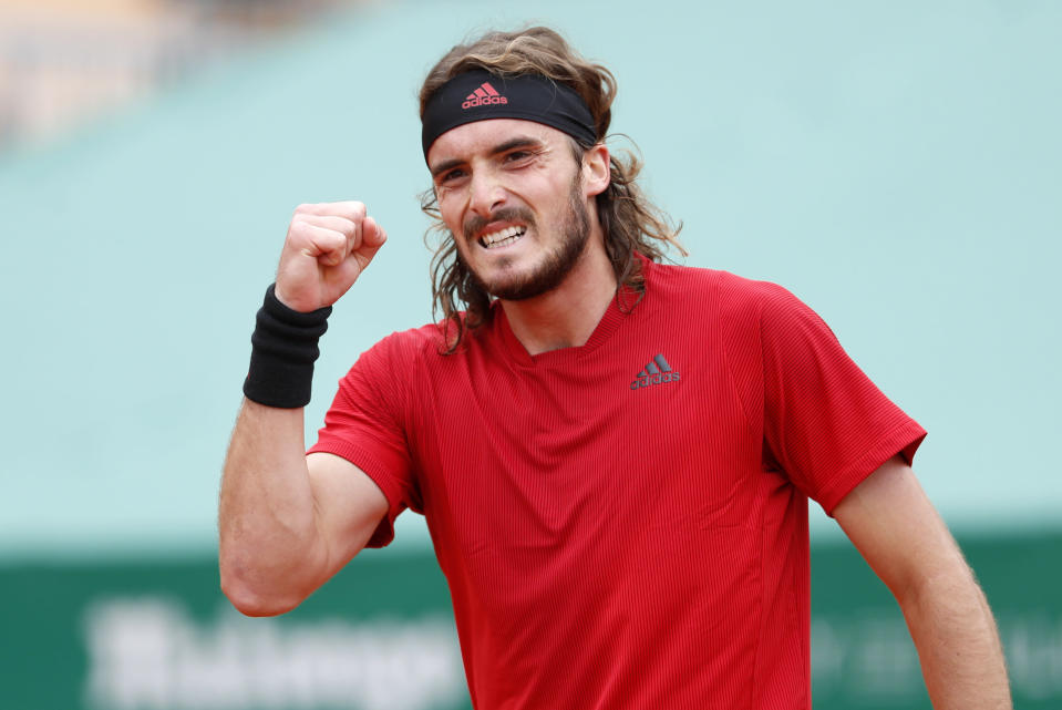 Stefanos Tsitsipas of Greece celebrates after defeating Daniel Evans of Britain in their semifinal match of the Monte Carlo Tennis Masters tournament in Monaco, Saturday, April 17, 2021. (AP Photo/Jean-Francois Badias)