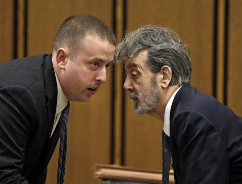 The man who calls himself Bobby Thompson, right, talks with defense attorney Joseph Patituce during opening arguments in court in Cleveland Monday, Oct. 7, 2013. Thompson, 67, who authorities have identified as John Donald Cody, is charged with masterminding a $100 million multistate fraud under the guise of helping Navy veterans. (AP Photo/Mark Duncan)