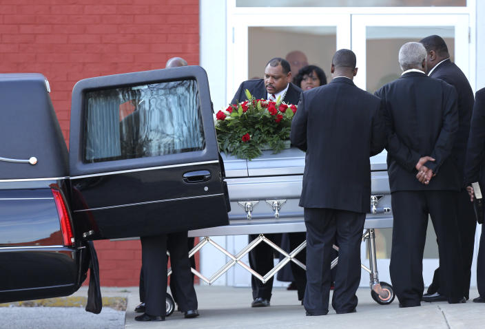 Pallbearers place a coffin with the body of Kansas City Chiefs NFL football player Jovan Belcher into a hearse after a service at the Landmark International Deliverance and Worship Center Wednesday, Dec. 5, 2012 in Kansas City, Mo. Belcher shot his girlfriend, Kasandra Perkins, at their home Saturday morning before driving to Arrowhead Stadium and turning the gun on himself. (AP Photo/Ed Zurga)