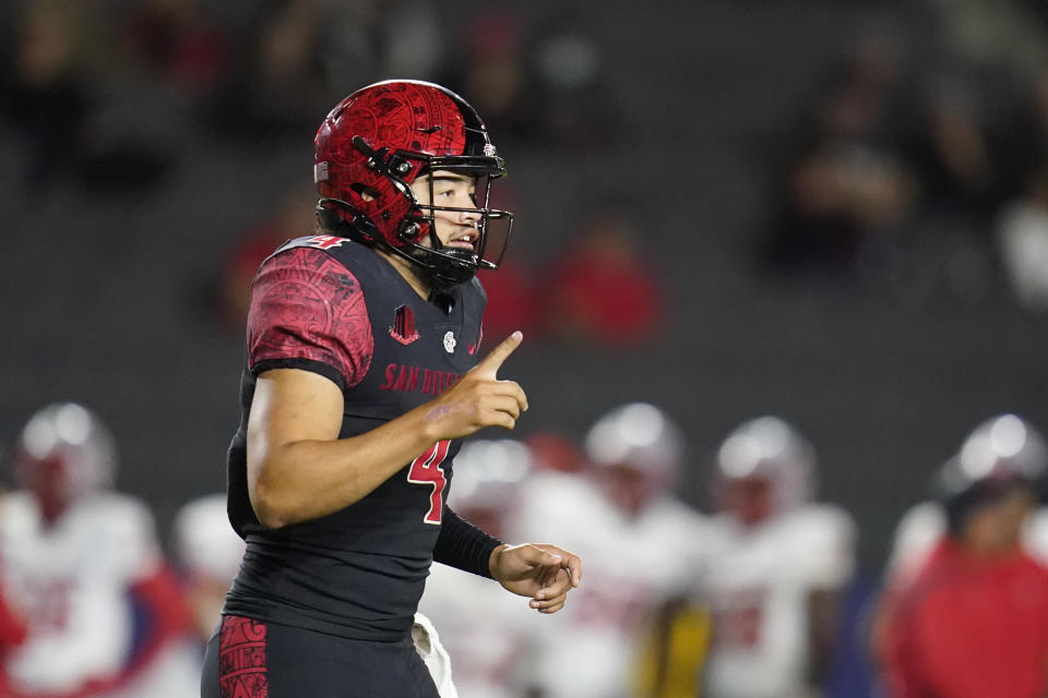 San Diego State quarterback Jordon Brookshire (4) celebrates a touchdown during the second half of an NCAA college football game against New Mexico Saturday, Oct. 9, 2021, in Carson, Calif. (AP Photo/Ashley Landis)