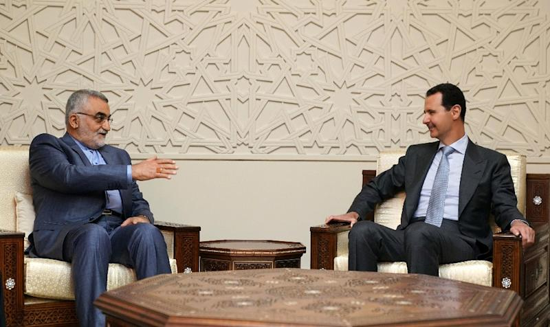 A handout picture released by Syria's official SANA news agency on April 30, 2018 shows Syrian President Bashar al-Assad (R) holding talks with senior Iranian official Alaeddin Boroujerdi in Damascus (AFP Photo/HO)