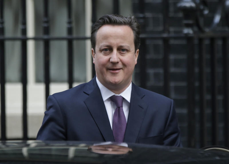 Britain's Prime Minister David Cameron leaves his official residence at 10 Downing Street in central London, on his way to the Houses of Parliament to address lawmakers, Wednesday, Jan. 16, 2013. (AP Photo/Lefteris Pitarakis)