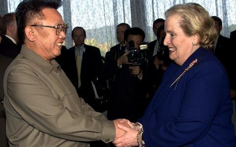 <span>Former North Korean Leader Kim Jong Il shakes hands with US Secretary of State Madeleine Albright </span> <span>Credit: AP Photo/David Guttenfelder, Pool, File </span>