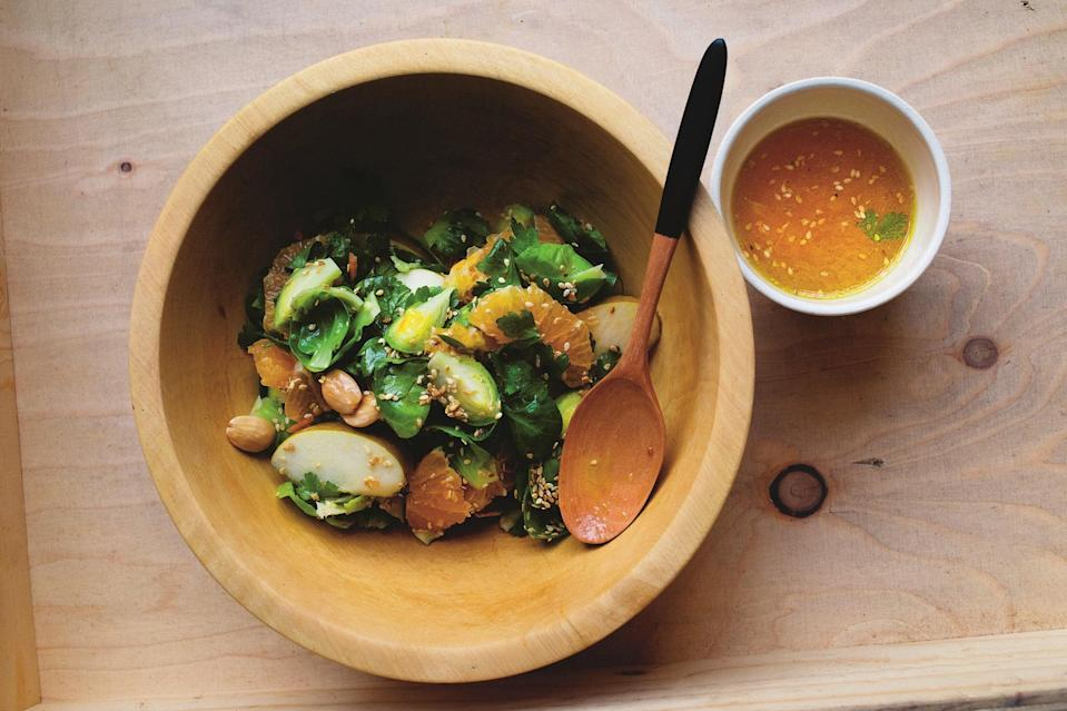 """A salad of Brussels sprouts sounds boring, but this one has enough citrus, almonds, and rough-skinned apples to be interesting. A dressing made with liquid honey and clementine zest removes any notion of worthiness. There are a few sesame seeds and some flat-leaf parsley, but it's not complicated with unnecessary ingredients. <a href=""""https://www.epicurious.com/recipes/food/views/a-salad-of-brussels-sprouts-clementines-and-russet-apple?mbid=synd_yahoo_rss"""" rel=""""nofollow noopener"""" target=""""_blank"""" data-ylk=""""slk:See recipe."""" class=""""link rapid-noclick-resp"""">See recipe.</a>"""