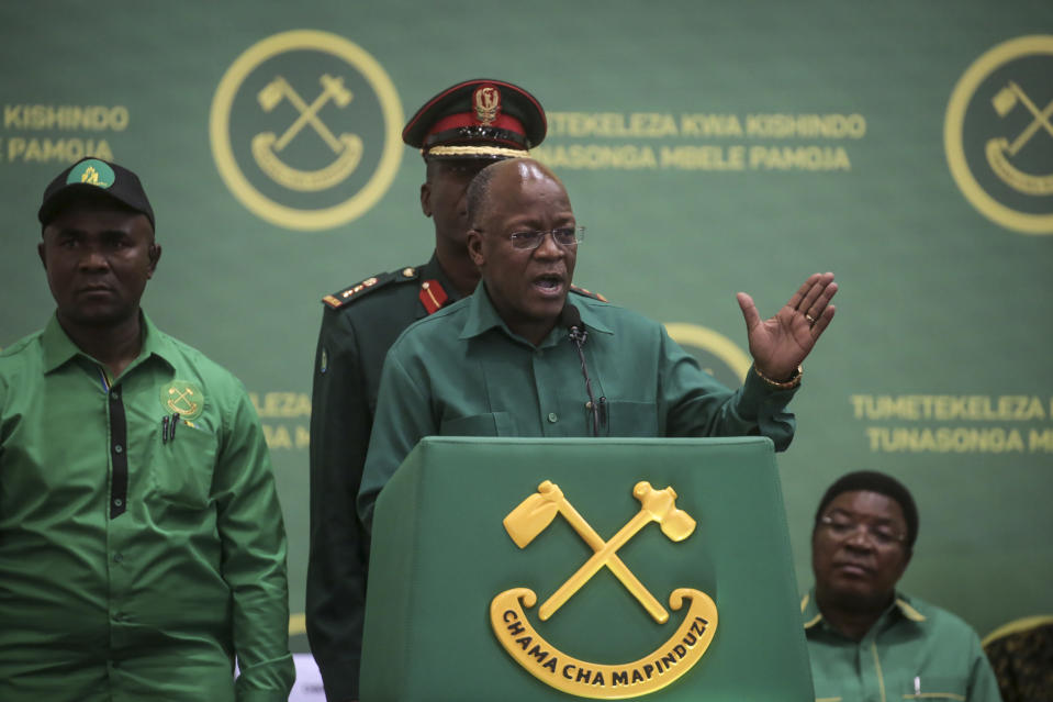 FILE - In this July 11, 2020 file photo, Tanzania's President John Magufuli speaks at the national congress of his ruling Chama cha Mapinduzi (CCM) party in Dodoma, Tanzania. Tanzania's president John Magufuli is finally acknowledging Sunday, Feb. 21, 2021 that his country has a coronavirus problem after claiming for months that the disease had been defeated by prayer, urging citizens to take precautions and even wear face masks - but only locally made ones. (AP Photo, File)