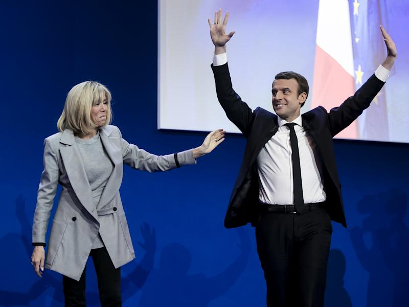 Emmanuel Macron with his wife Brigitte Trogneux addresses activists after the announcement of the French presidential election results: Getty