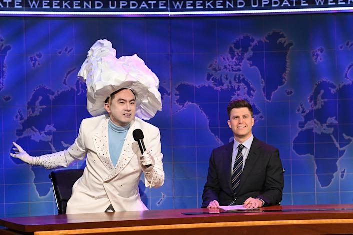 Bowen Yang as 'The Iceberg That Sank The Titanic' and anchor Colin Jost during Weekend Update on Saturday, April 10, 2021. (Will Heath / NBC)
