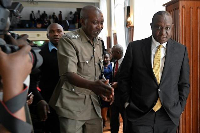 Kenyan Finance Minister Henry Rotich (R) appeared in a packed Nairobi court to be charged with more than 10 financial crimes including fraud (AFP Photo/SIMON MAINA)