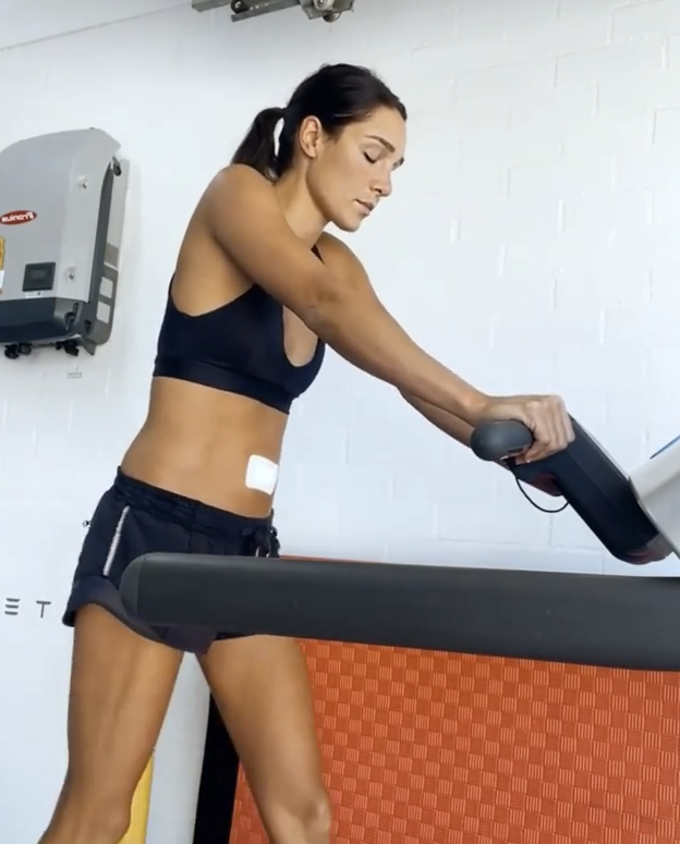 Kayla itsines doing some light walking on the treadmill after surgery