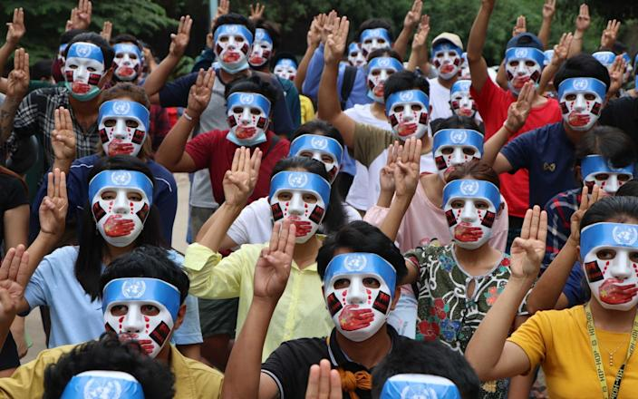 People, with their masks, stage a demonstration to protest against military coup in Yangon, Myanmar  - Anadolu