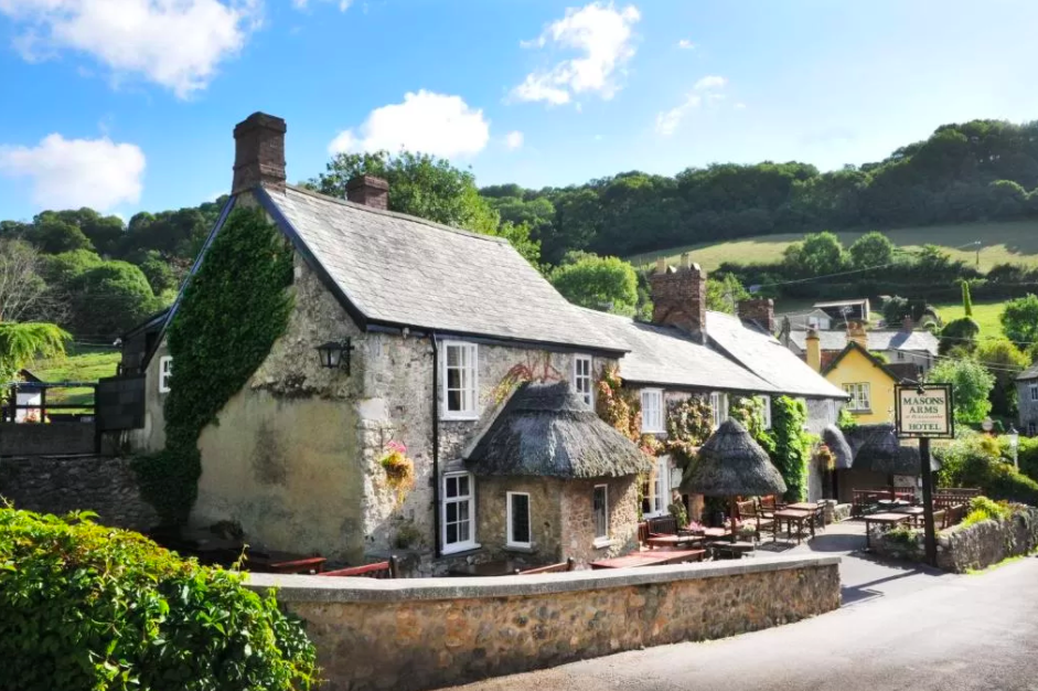 "<p><a href=""https://go.redirectingat.com?id=127X1599956&url=https%3A%2F%2Fwww.booking.com%2Fhotel%2Fgb%2Fthe-masons-arms-branscombe.en-gb.html%3Faid%3D1922306%26label%3Dstaycation-uk&sref=https%3A%2F%2Fwww.goodhousekeeping.com%2Fuk%2Flifestyle%2Ftravel%2Fg34842793%2Fstaycation-uk%2F"" rel=""nofollow noopener"" target=""_blank"" data-ylk=""slk:The Masons Arms"" class=""link rapid-noclick-resp"">The Masons Arms</a>' in Branscombe, believed to be the longest village in England, occupies a position nestled amongst the quaint thatched cottages, with a luscious hilly backdrop. </p><p>The 14th century thatched inn boasts 27 contemporary bedrooms, a cosy bar complete with inglenook fireplace and a comfortable, relaxed ambience. </p><p>The area sweeps towards Branscombe Beach, a long shingle cove, where keen walkers can join the South West Coastal Path and less keen0walkers can dip their toes in the cool (read: chilly) waters.</p><p>Meander into the village to explore its working forge and grab a baked treat from the old bakery, or venture further afield to take advantage of fossil hunting along the Jurassic Coast. </p><p><a href=""https://www.goodhousekeepingholidays.com/offers/devon-branscombe-masons-arms-hotel"" rel=""nofollow noopener"" target=""_blank"" data-ylk=""slk:Read our hotel review of the Masons Arms here"" class=""link rapid-noclick-resp"">Read our hotel review of the Masons Arms here</a></p><p><a class=""link rapid-noclick-resp"" href=""https://go.redirectingat.com?id=127X1599956&url=https%3A%2F%2Fwww.booking.com%2Fhotel%2Fgb%2Fthe-masons-arms-branscombe.en-gb.html%3Faid%3D1922306%26label%3Dstaycation-uk&sref=https%3A%2F%2Fwww.goodhousekeeping.com%2Fuk%2Flifestyle%2Ftravel%2Fg34842793%2Fstaycation-uk%2F"" rel=""nofollow noopener"" target=""_blank"" data-ylk=""slk:CHECK AVAILABILITY"">CHECK AVAILABILITY</a></p>"