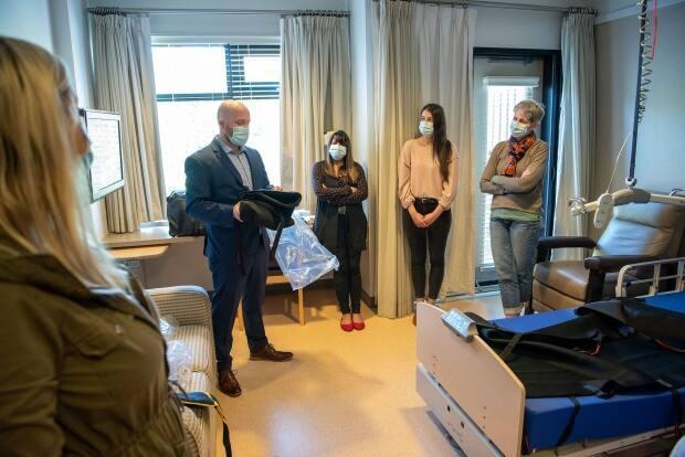 Officials mark the reopening of the Irene Thomas Hospice under the operation of the Fraser Health authority on April 15. (Submitted by Fraser Health/Steve Ray  - image credit)