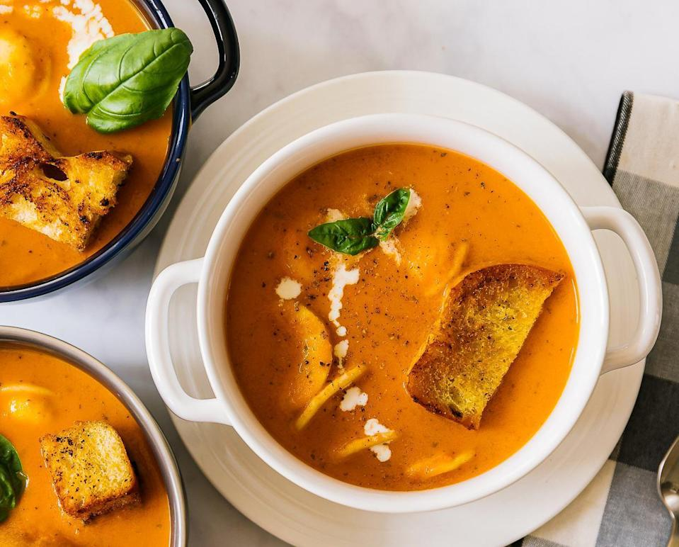 "<p>Silky tomato soup is nostalgic and fuss-free. Pair it with a simple grilled cheese sandwich for a comforting lunch or dinner. The savory flavors of roasted garlic and fresh basil and a sprinkle of salty parmesan cheese are what make this made-from-scratch soup rich and deeply satisfying. To make this recipe <a href=""https://www.thedailymeal.com/eat/best-vegan-restaurant-in-every-state?referrer=yahoo&category=beauty_food&include_utm=1&utm_medium=referral&utm_source=yahoo&utm_campaign=feed"" rel=""nofollow noopener"" target=""_blank"" data-ylk=""slk:vegan-friendly"" class=""link rapid-noclick-resp"">vegan-friendly</a>, simply substitute vegetable broth for the chicken broth, and when it's time to add the cream, either omit it completely or add a splash of coconut milk.</p> <p><a href=""https://www.thedailymeal.com/best-recipes/tomato-basil-soup-freezer-homecooked-recipe?referrer=yahoo&category=beauty_food&include_utm=1&utm_medium=referral&utm_source=yahoo&utm_campaign=feed"" rel=""nofollow noopener"" target=""_blank"" data-ylk=""slk:For the Tomato Basil Soup recipe, click here."" class=""link rapid-noclick-resp"">For the Tomato Basil Soup recipe, click here.</a> </p>"
