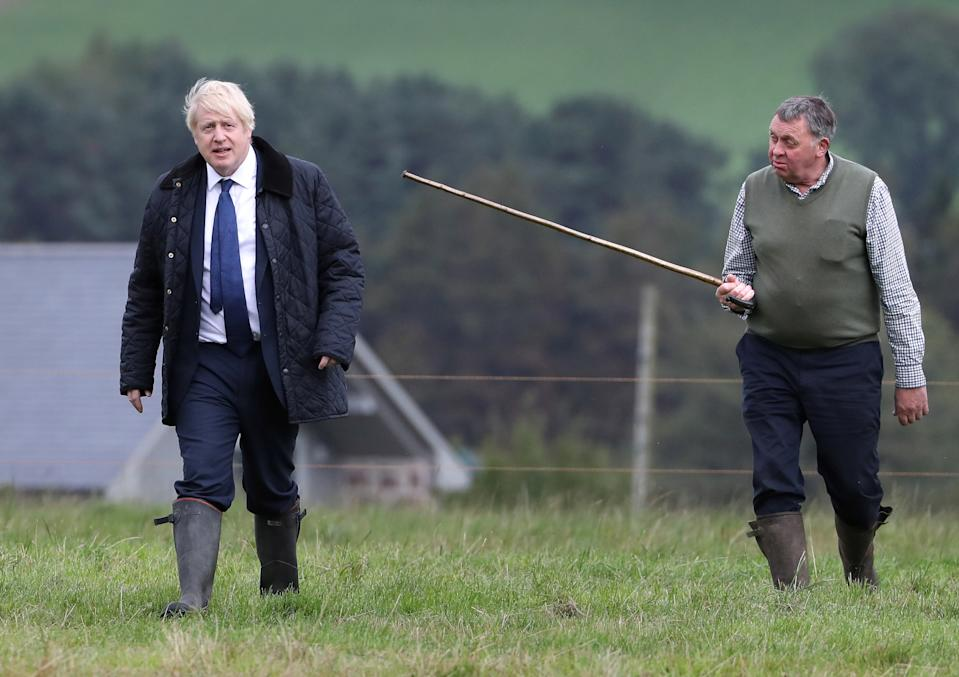 Britain's Prime Minister Boris Johnson and Farmer Peter Watson are seen during a visit at Darnford Farm in Darnford, Banchory near Aberdeen, Scotland, Britain September 6, 2019. Andrew Milligan/Pool via REUTERS