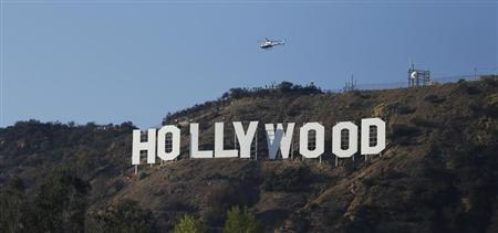 A LAPD helicopter flies over the Hollywood sign in Hollywood
