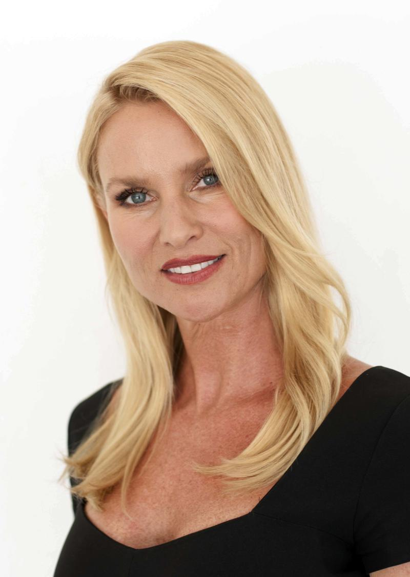 """FILE - In this July 27, 2011 file photo, actress Nicollette Sheridan poses for a portrait at during The Television Critics Association 2011 Summer Press Tour in Beverly Hills, Calif.  Sheridan concluded testifying Monday, March 5, 2012, in Los Angeles and """"Desperate Housewives"""" creator Marc Cherry told jurors he planned to kill off the actress' character four months before he allegedly hit her on the show's set in September 2008. (AP Photo/Dan Steinberg, file)"""