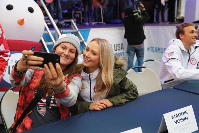 <p>Skier Devin Logan (L) and skier Maggie Voisin take a selfie during the 100 Days Out 2018 PyeongChang Winter Olympics Celebration – Team USA in Times Square on November 1, 2017 in New York City. (Photo by Elsa/Getty Images for USOC) </p>