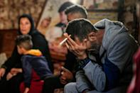 Hadi, the father of one of four boys from the Bakr family killed in Israeli fire while playing on a beach during the 2014 war in Gaza, gathered with relatives under images of the slain boys at a family home in the Al-Shati refugee camp this month