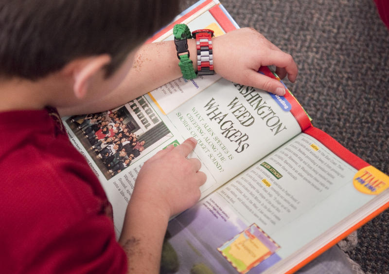 In this Jan. 23, 2013 photo Jefferson Elementary third grader Anthony Grinnel works on a reading assignment in Wichita, Kan. Kansas is one of an increasing number of states that are not promoting students who are struggling to read at the end of third grade. Thirty-two states have passed legislation designed to improve third-grade literacy, according to the Education Commission of the States. (AP Photo/Mike Hutmacher)