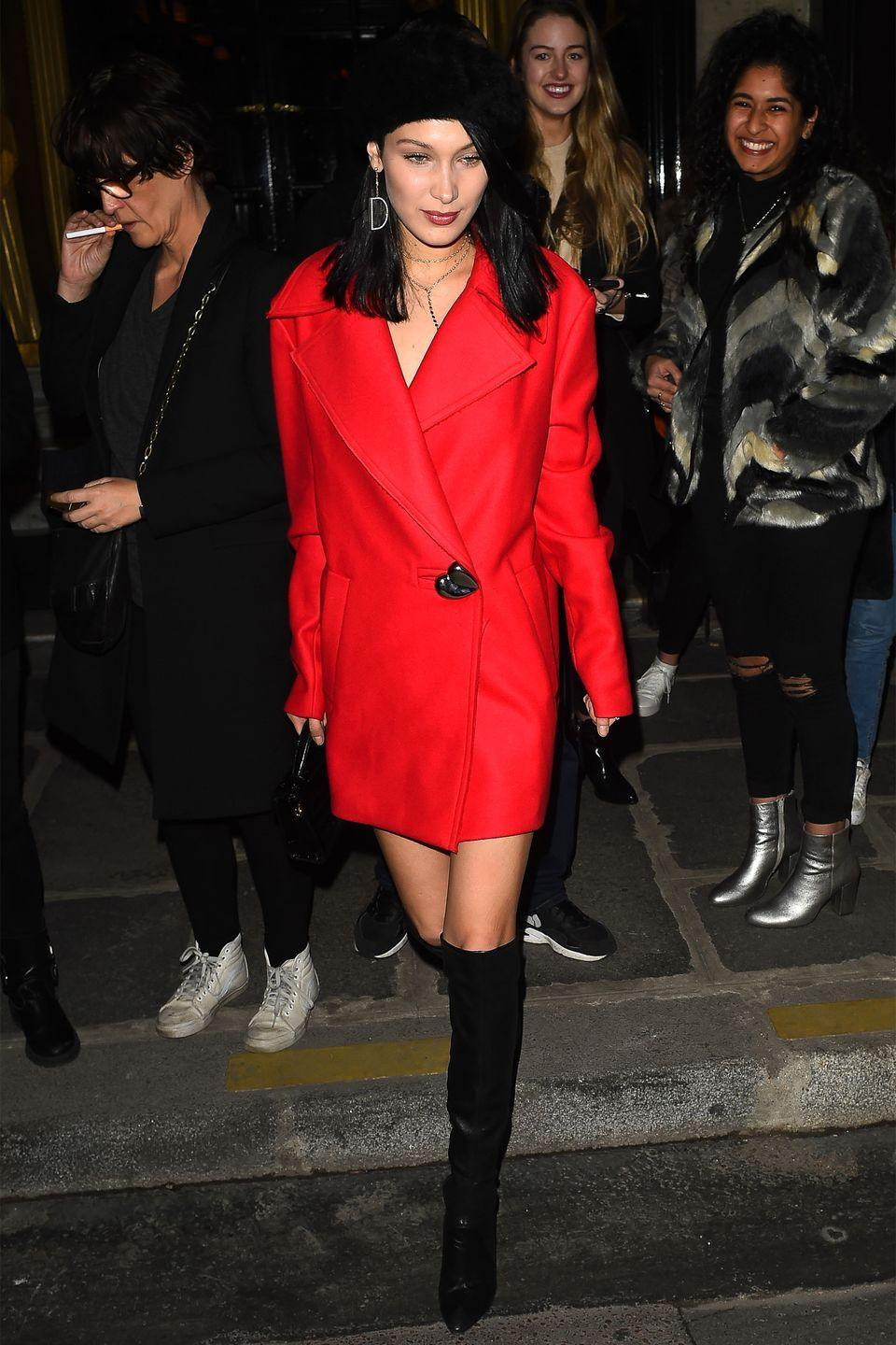 <p>In a Charlotte Simone beret, red coat, leather over-the-knee boots and patent leather handbag while out in Paris.</p>