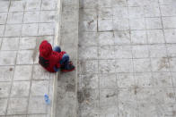 A child recently expelled from the U.S. after trying to seek asylum sits next to the international bridge in the Mexican border city of Reynosa, Saturday, March 27, 2021. Dozens of migrants who earlier tried to cross into the U.S. in order to seek asylum have been expelled from the U.S. under pandemic-related presidential authority. (AP Photo/Dario Lopez-Mills)