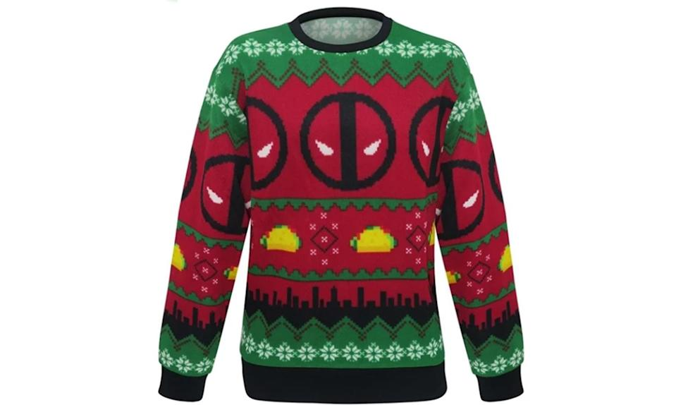 """<p>Tacos aren't a traditional holiday dish, but then Deadpool isn't your traditional kinda guy. Together, they make a spicy ugly Christmas sweater. <strong><a rel=""""nofollow noopener"""" href=""""https://www.superherostuff.com/deadpool/sweaters/deadpool-tacos-ugly-mens-christmas-sweater.html?itemcd=swtrdptacosugly"""" target=""""_blank"""" data-ylk=""""slk:Buy here"""" class=""""link rapid-noclick-resp"""">Buy here</a></strong> </p>"""