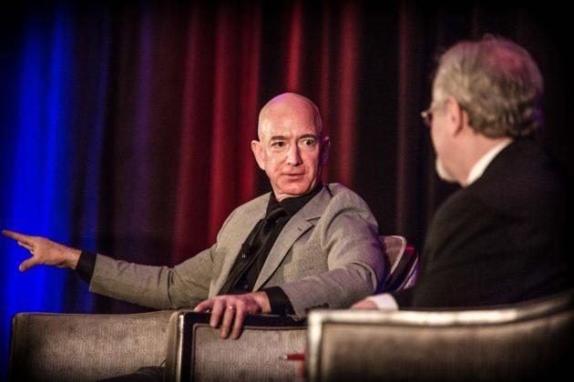 Jeff Bezos, the founder of Amazon and Blue Origin, discusses his vision for space settlement with GeekWire's Alan Boyle at the International Space Development Conference in Los Angeles. (Keith Zacharski / In The Barrel Photo)