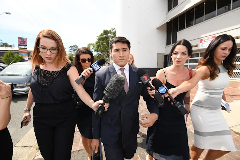 Lawyer Bryan Wrench (centre) leaves the Penrith Local Court in Sydney.