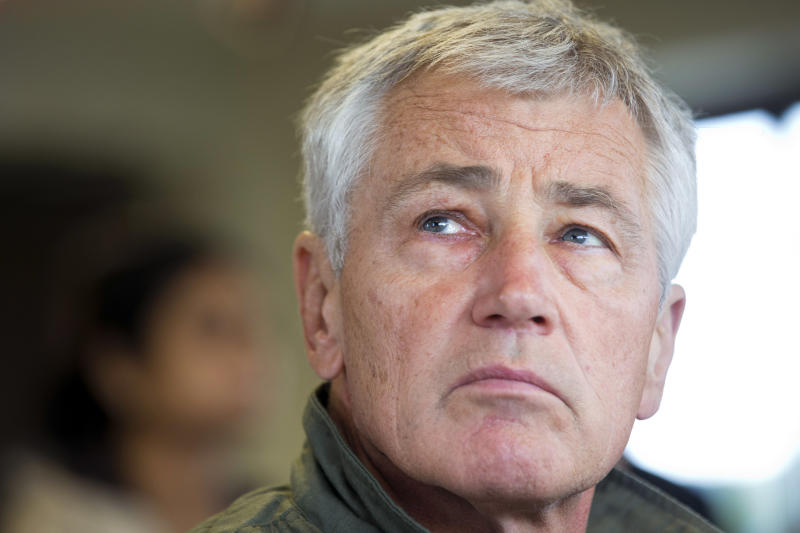 U.S. Secretary of Defense Chuck Hagel observes training at the Rodriguez Live Fire Complex (RLFC), near the Demilitarized Zone (DMZ), the military border separating the two Koreas, in South Korea, on Monday, Sept. 30, 2013. Hagel is in South Korea before heading to Japan for ministerial meetings. (AP Photo/Jacquelyn Martin, Pool)