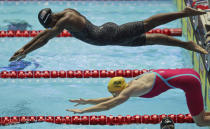File-This July 27, 2019, file photo shows the United States' Simone Manuel diving in for the final leg of the mixed 4x100m freestyle relay final at the World Swimming Championships in Gwangju, South Korea. Katie Ledecky is among several big names diving back in with three months to go until the U.S. Olympic trials. Caeleb Dressel, Manuel, double backstroke world-record holder Regan Smith, and Ryan Lochte will swim over four days in the first single-site American meet since the pandemic began. (AP Photo/Mark Schiefelbein, File)