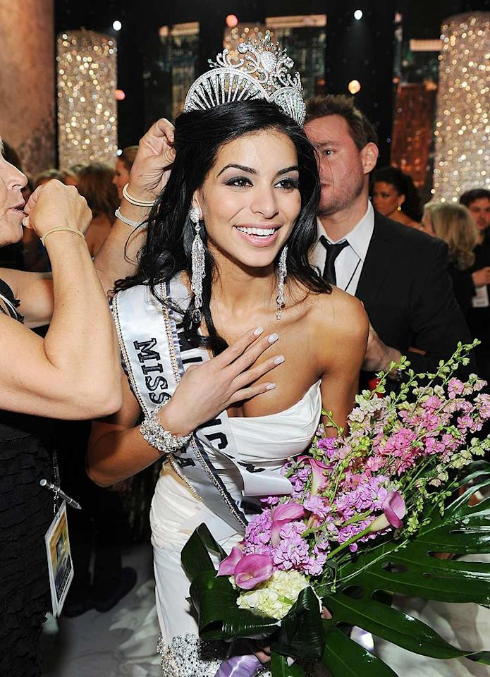 """Miss Michigan, Rima Fakih, 23, made history Sunday night after becoming only the second Arab-American -- after 1983's winner Julie Hayek -- to be crowned Miss USA. Asked how she felt after winning the crown, Fakih replied: """"Ask me after I've had a pizza."""" Denise Truscello/<a href=""""http://www.wireimage.com"""" target=""""new"""">WireImage.com</a> - May 16, 2010"""