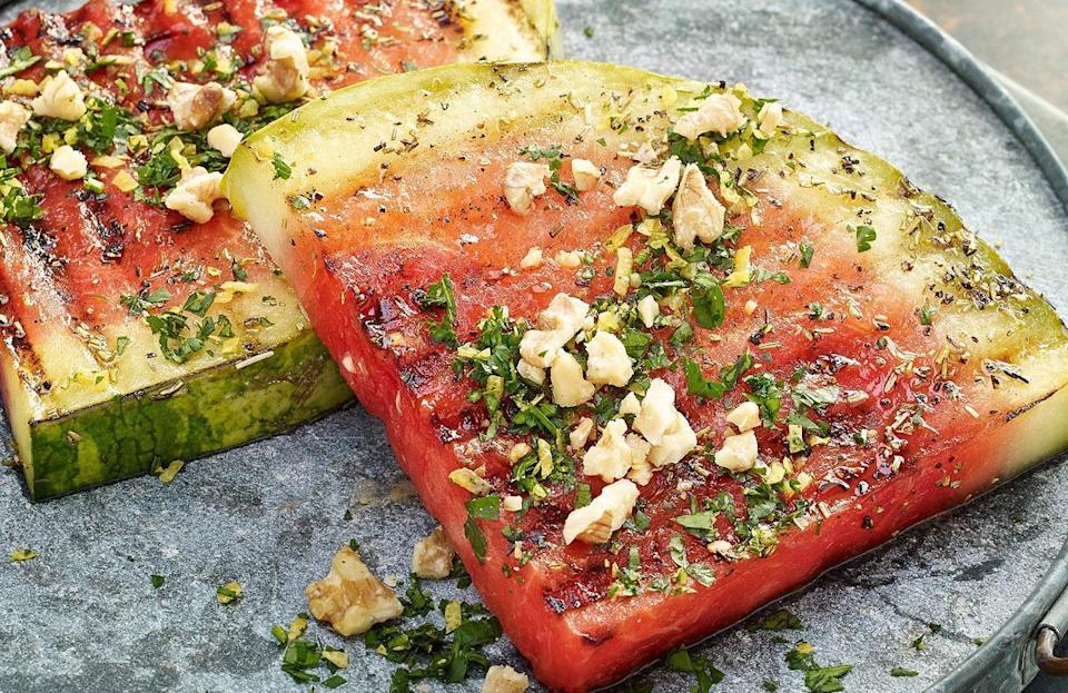 """<p>You can do a lot once you've <a href=""""https://www.thedailymeal.com/cook/how-pick-perfect-watermelon?referrer=yahoo&category=beauty_food&include_utm=1&utm_medium=referral&utm_source=yahoo&utm_campaign=feed"""" rel=""""nofollow noopener"""" target=""""_blank"""" data-ylk=""""slk:picked out the perfect watermelon"""" class=""""link rapid-noclick-resp"""">picked out the perfect watermelon</a> — including grilling. Marinate your watermelon """"steaks"""" with a mix of oil, vinegar, lemon juice, rosemary, salt and pepper. After they're done on the grill, top them off with a walnut gremolata.</p> <p><a href=""""https://www.thedailymeal.com/best-recipes/grilled-watermelon-steaks?referrer=yahoo&category=beauty_food&include_utm=1&utm_medium=referral&utm_source=yahoo&utm_campaign=feed"""" rel=""""nofollow noopener"""" target=""""_blank"""" data-ylk=""""slk:For the Grilled Watermelon Steaks With Walnut Gremolata recipe, click here."""" class=""""link rapid-noclick-resp"""">For the Grilled Watermelon Steaks With Walnut Gremolata recipe, click here.</a></p>"""