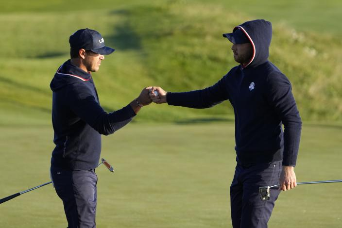 Team USA's Daniel Berger and Team USA's Brooks Koepka react after winning the second hole during a foursomes match the Ryder Cup at the Whistling Straits Golf Course Saturday, Sept. 25, 2021, in Sheboygan, Wis. (AP Photo/Jeff Roberson)