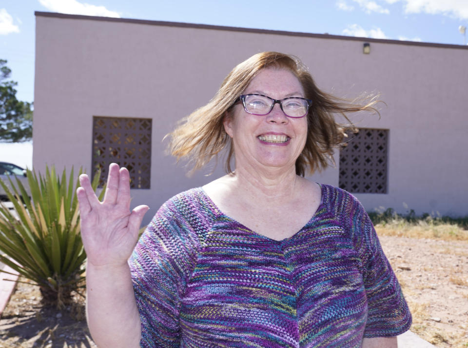 Van Horn Mayor Becky Brewster shows-off a Star Trek themed hand sign as she poses for a photo in Van Horn, Texas, Tuesday Oct. 12, 2021. The nearby Blue Origin launch site is 20 miles north of her city. (AP Photo/LM Otero)