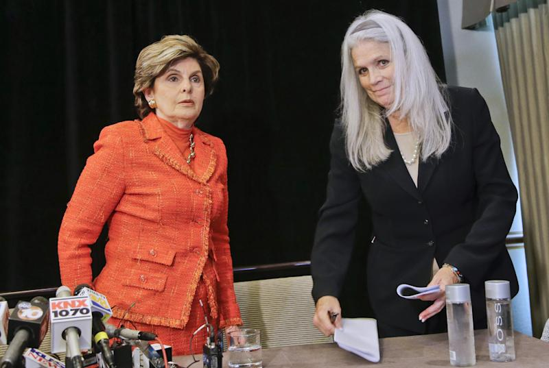 Attorney Gloria Allred, left, with her client, Irene McCormack, prepare to leave a news conference where they revealed details regarding their accusations of sexual misconduct against San Diego Mayor Bob Filner in San Diego, Monday, July 22, 2013. Ms. McCormack was the Communications Director for Mayor Filner. (AP Photo/Lenny Ignelzi)