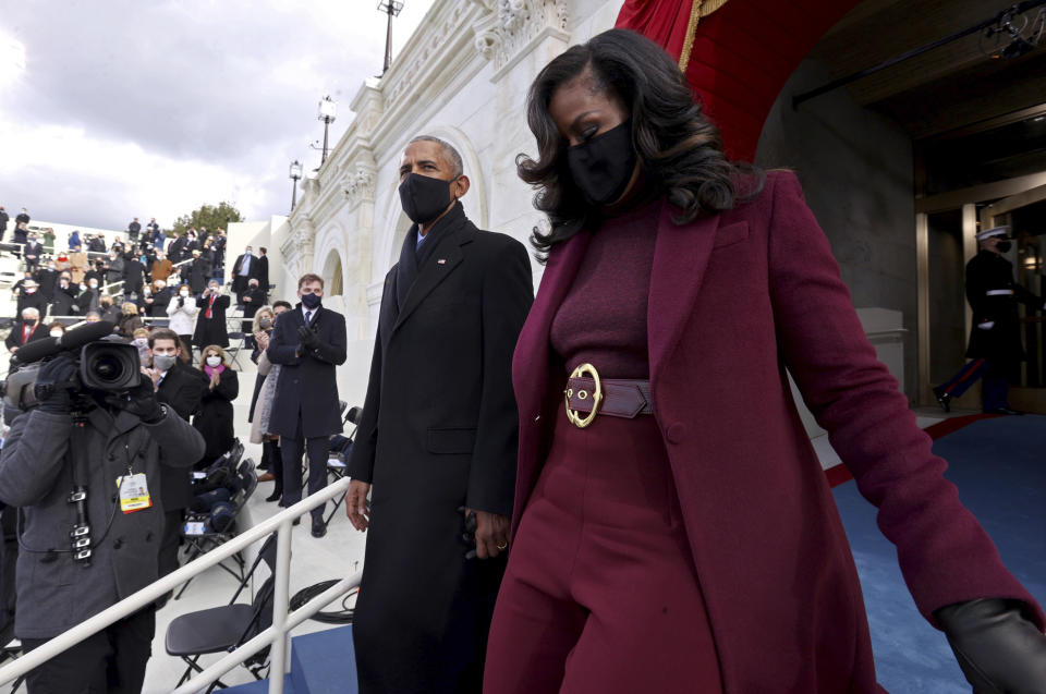 Former U.S. President Barack Obama and wife Michelle, arrive to attend the 59th Presidential Inauguration at the U.S. Capitol in Washington, Wednesday, Jan. 20, 2021. Joe Biden was sworn in as the 46th president of the U.S. and Kamala Harris became the first woman vice president. (Jonathan Ernst/Pool Photo via AP)