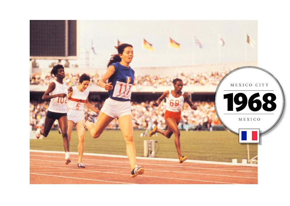 French runner Colette Besson added some color to the track at the 1968 Summer Olympics in Mexico City when she wore a bright blue t-shirt (which was rolled and tucked, to become a tank-top). She also often wore pigtails, tied with a red ribbon. (Getty Images)