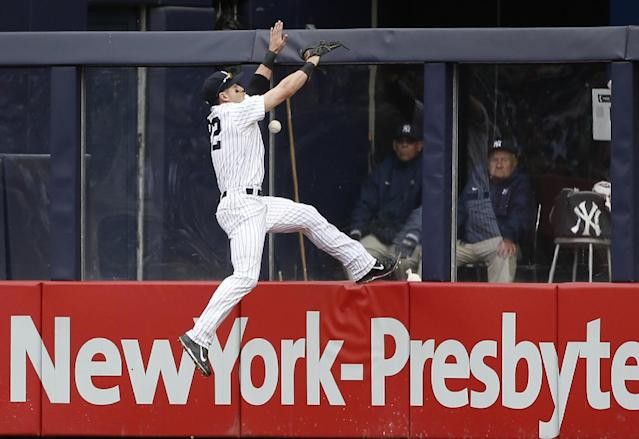 New York Yankees center fielder Jacoby Ellsbury leaps for but cannot field Tampa Bay Rays' Wil Myers' third-inning inside-the-park home run during a baseball game at Yankee Stadium in New York, Sunday, May 4, 2014. (AP Photo/Kathy Willens)