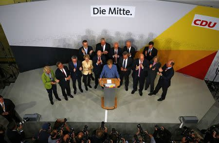 Christian Democratic Union CDU party leader and German Chancellor Angela Merkel reacts on first exit polls in the German general election (Bundestagswahl) in Berlin, Germany, September 24, 2017. REUTERS/Pawel Kopczynski