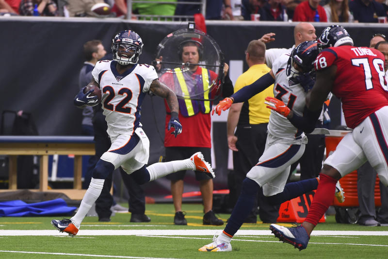 Denver Broncos strong safety Kareem Jackson (22) returns a fumble for a touchdown against the Houston Texans during the first half of an NFL football game Sunday, Dec. 8, 2019, in Houston. (AP Photo/Eric Christian Smith)