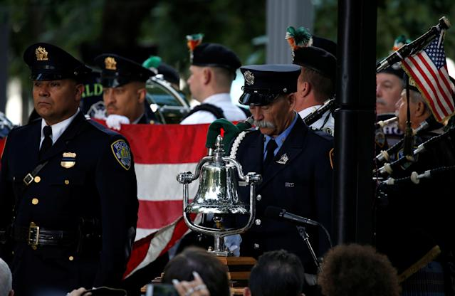 <p>Officers stand in silence at the National September 11 Memorial and Museum during ceremonies marking the 16th anniversary of the Sept. 11, 2001, attacks in New York, Sept. 11, 2017. (Photo: Brendan McDermid/Reuters) </p>