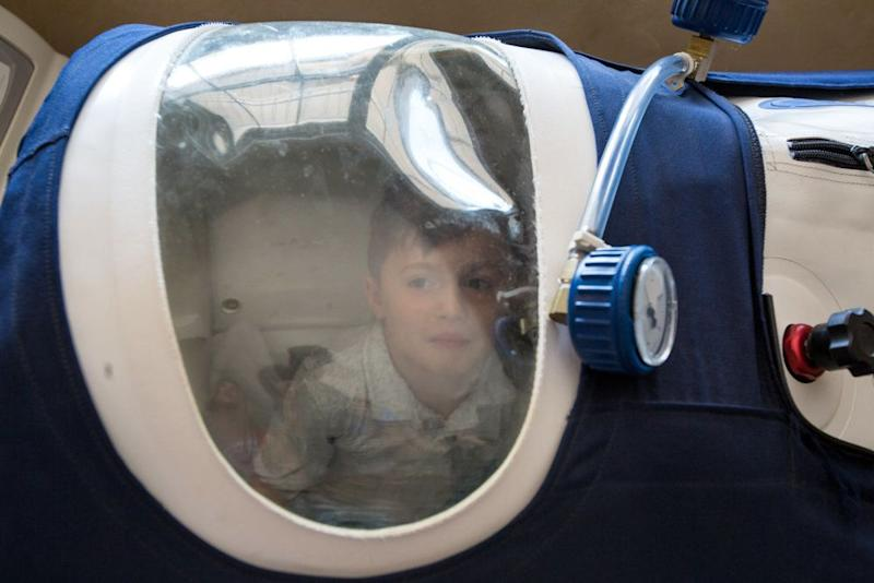 "Jamesy often sleeps in a hyperbaric chamber to help improve his breathing, and his dad always joins him. He has been diagnosed with <a href=""https://ghr.nlm.nih.gov/condition/duchenne-and-becker-muscular-dystrophy"" target=""_blank"">Duchenne muscular dystrophy.</a>"
