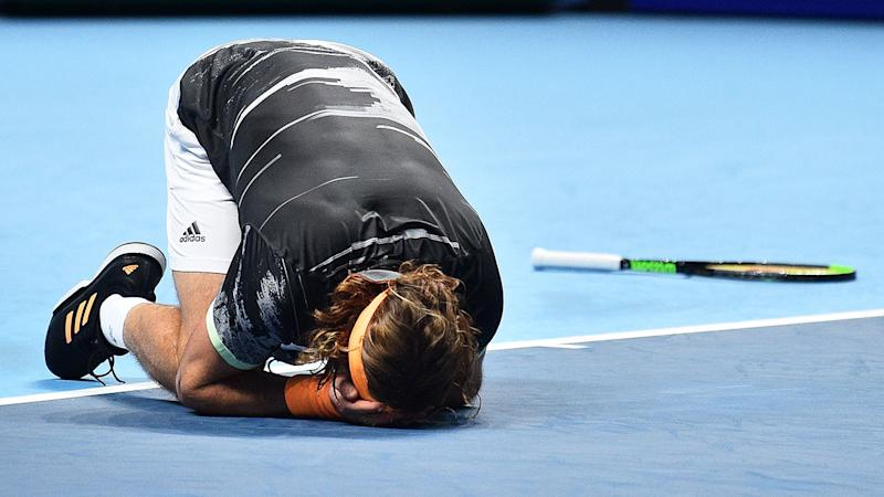 Pictured here, an emotional Stefanos Tsitsipas reacts to his ATP Finals victory.