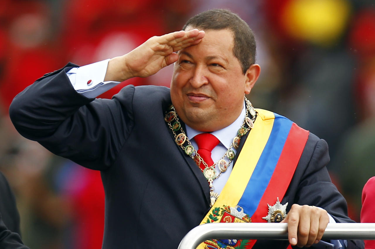 Venezuelan President Hugo Chavez arrives at a military parade to commemorate the 20th anniversary of his failed coup attempt in Caracas February 4, 2012. REUTERS/Jorge Silva