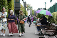 Spectators arrive for day nine of the Wimbledon Tennis Championships in London, Wednesday, July 7, 2021. (AP Photo/Alberto Pezzali)