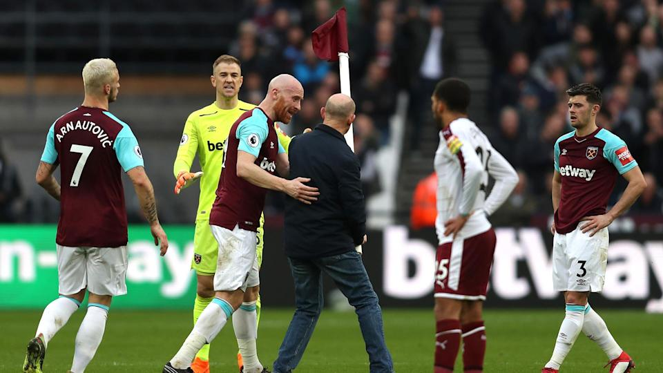 Supporters' anger spilled over onto the pitch as Saturday's defeat to Burnley was interrupted several times